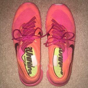 orange and pink nike barefoot rids!